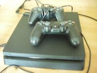 Play station 4 in working order with 2 controllers