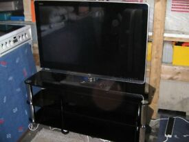 "41"" sharp Aquos colour TV and Glass table stained"
