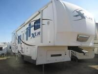PRE OWNED 2009 FOREST RIVER XLR 30X12 TOY HAULER FIFTH WHEEL