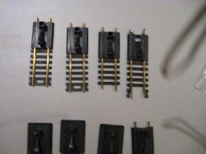 Lot Of 8 HO Scale BRASS Track Posts/Ends