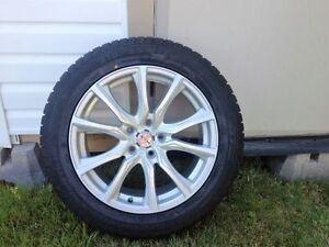 4 Brand new Champiro Winter Pro HP tires and new Aluminum rims.