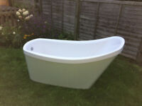 free standing bath, in good condition, taps included.