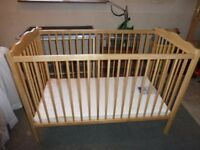 Mothercare wood dropsided childs cot. used but still in good usable condition. mattress has a split.