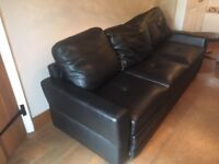 Large faux leather black sofa bed