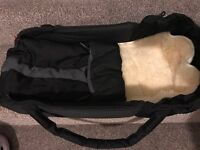 Phil & Ted Black Cocoon (worth £60) with sheepskin insert (worth £40) (worth £100 in total)