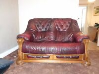 Very attractive red wine two seater settee