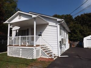 LOADS OF POTENTIAL AND INCOME!   MLS® #:  02826410