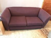 2/3 seater sofa, contemporary style, aubergine colour, oak legs, good condition, 1 leg needs glueing