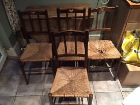 Four farmhouse style kitchen chairs with wickerwork seats