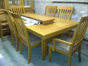 LIGHT OAK DINING TABLE AND HUTCH