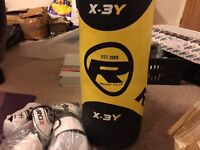 brand new punch bag with boxing gloves