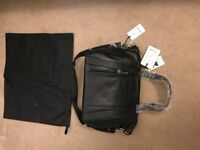 Brand new- Bugaboo by Storksac black leather bag (duplicate gift)