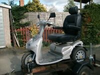 TGA Breeze 3 all terrain mobility scooter with ramped road trailer