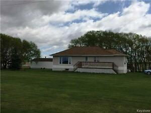 Country acreage with outbuildings close to Hamiota MB!