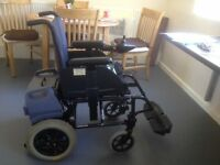 Electric Wheelchair - Converts to a manual self propelled wheelchair. New batteries
