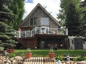 Beautifully Updated Lake Front Cottage With Private Dock