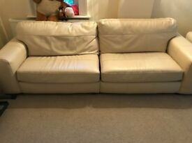 2 large cream leather sofas for sale, signs of wear and tear but otherwise good condition