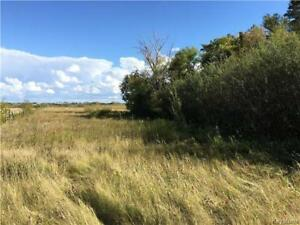 Mature lot on the edge of town in the community of Cardale MB