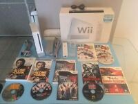 WII CONSOLE + MANETTE+NUNCHOCK + NHL-LUTTE-ETC-95$