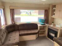 Cheap static caravan , sea views , dog friendly , swimming pool and flume , beach access , facilties