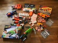 A Huge Collection Of Nerf Guns And Bullets