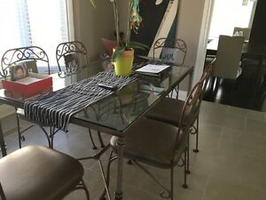 Glass top wrought iron tabale with 6 chairs/Can sell separately