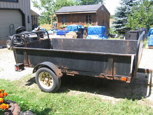 4 x 8 Utility Trailer with dumping feature.