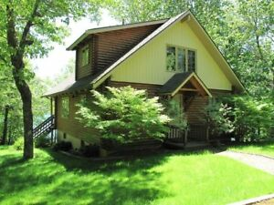 Great Lake Views At This Well Maintained Lake Front Log Home