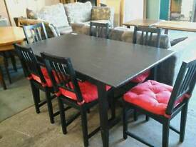 Modern black wooden extending dining table and 6 chairs