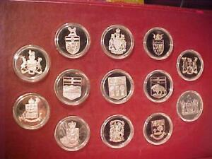 *RARE*RARE*RARE**THE OFFICIAL COATS OF ARMS of CANADA-13 SOLID STERLING COINS