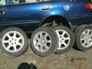 15 in. Alloy rims on  185/60/15 Motomaster Tires