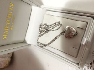 Silver locket with original receipt and box