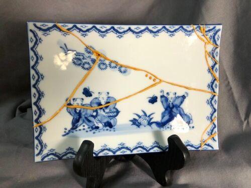 Kintsugi Japanese style repair technique, blue/white design porcelain dish,vg