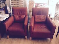A pair of Gerard Van Der Berg leather armchairs from Conran