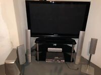 "Panasonic 52"" flat screen TV with Surround Sound and stand"