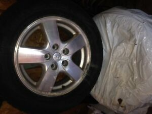 A set of 4 summer tires with rims for sale