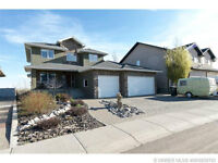 2 STOREY WITH AMAZING COULEE VIEW&TRIPLE GARAGE!