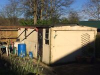 Free Concrete sectioned Garage with double doors at front ,approx 5.8 m x 3.35 m -Free to collect