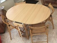 butterfly table and four chairs