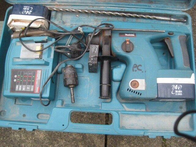 Makita 24v drill with 2 batteries and charger and chisels ,drills
