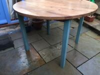 Pine circular table, approximately 3ft 6 inches across 28 and half inches high.