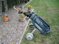 full set of left-hand golf clubs plus golf trolley