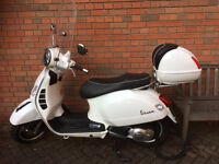 As New Vespa GTS 125 With Low Miles.