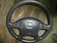 honda strerring wheel with air bag asking$75  450-628-4656> 514