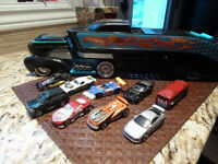 Mattel Hot Wheels Super Transporter with 9 cars and playmat