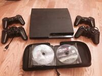 160GB Slimline Playstation 3 + four controllers + 22 games
