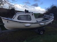 15 foot long fibreglass fishing boat with 3 man front cuddy & galvanised snipe trailer