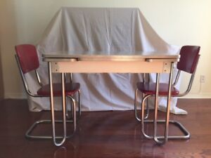 Vintage grey table from the 50's and four red vinyl chairs