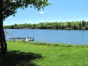 Lake Front With Great Lake View, A Well Maintained Log Cabin