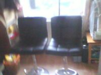 Pair black swivel stools.